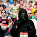 Scene from London Marathon showing runner in a Gorilla costume
